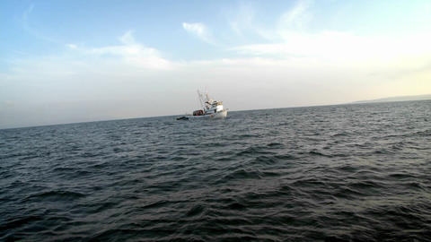 A small boat idles in open waters Stock Video Footage