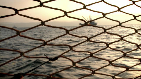 A ship is seen from a pier Stock Video Footage