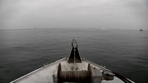Several boats navigate in open waters Footage