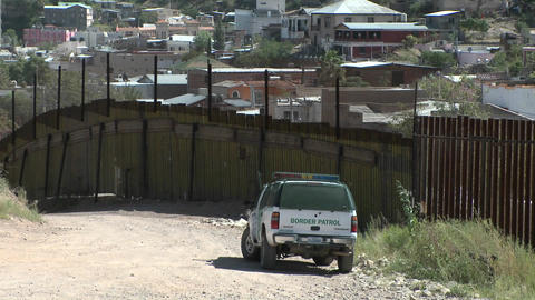 A border patrol vehicle is stationed at a border Footage