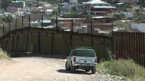 A border patrol vehicle is stationed at a border Stock Video Footage