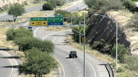 Vehicles travel along a highway close to the Mexican boarder Stock Video Footage