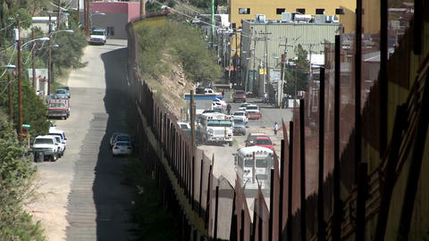 A border fence shows the separation of a community... Stock Video Footage