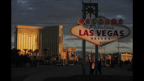 A sign welcomes people to Las Vegas as traffic and... Stock Video Footage