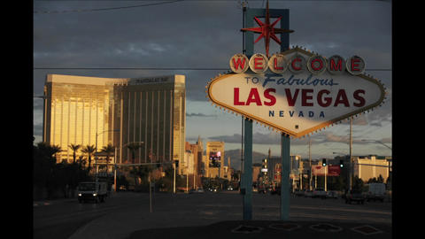 A sign welcomes people to Las Vegas as traffic and pedestrians pass by Footage
