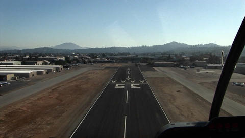 A plane heads down a runway and takes off Footage