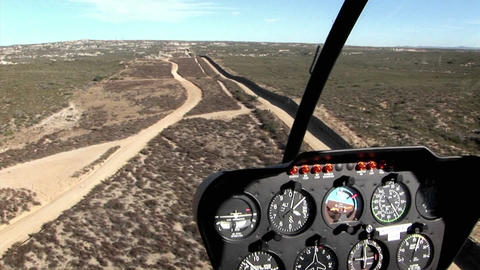 A pilot flies along the U.S. boarder Stock Video Footage