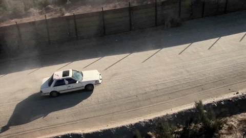 A car drives through a remote area Footage