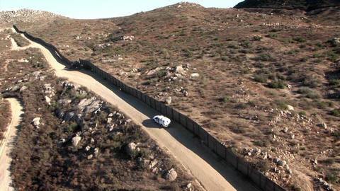A car drives along a remote road Stock Video Footage
