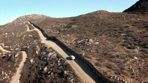 A car drives along a remote road Footage