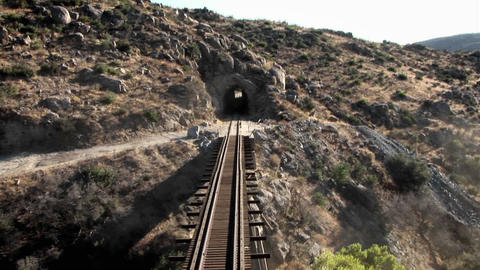 Train tracks go through a tunnel Stock Video Footage