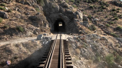 Train tracks go through a tunnel Footage