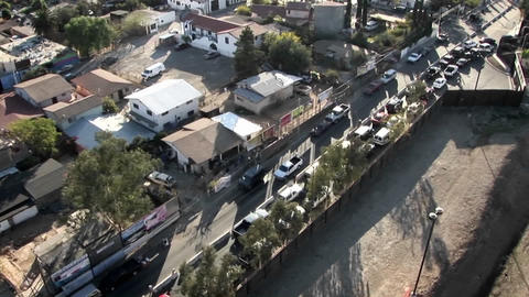 A row of cars is lined up to make a turn, and other cars... Stock Video Footage