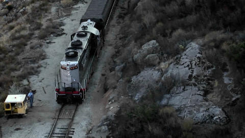 A man stands beside the tracks and watches a train as it... Stock Video Footage