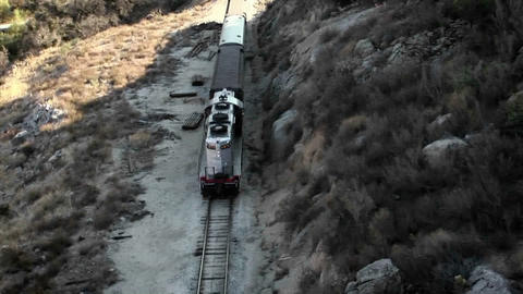 A man stands beside the tracks and watches a train as it goes by Footage