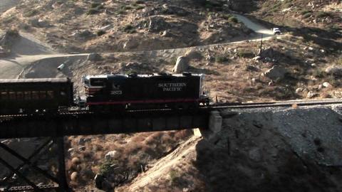 A railroad train crosses over a bridge Stock Video Footage