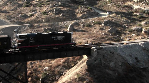 A railroad train crosses over a bridge Footage