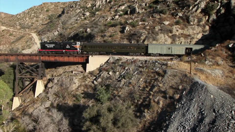 A freight train is traveling through a mountain tunnel Stock Video Footage