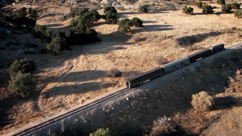 A train travels through a remote area Stock Video Footage