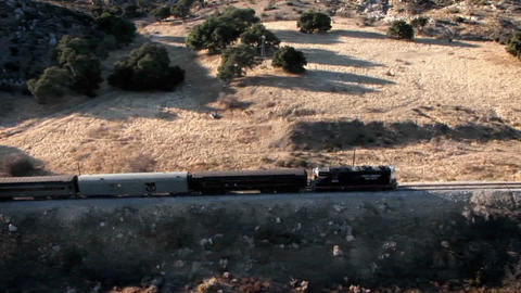 A train travels through a remote area Footage