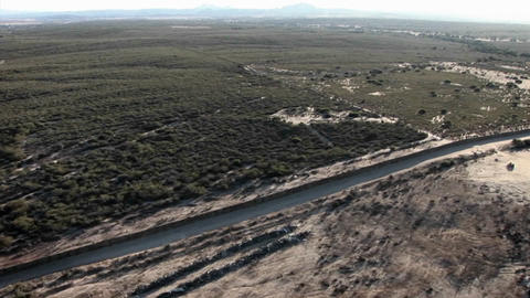 A daytime aerial view of a waterway traversing through a... Stock Video Footage