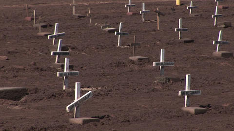 "Many white wooden crosses marked only with the phrase no olvidado"" (not forgotten) are displayed in Footage"