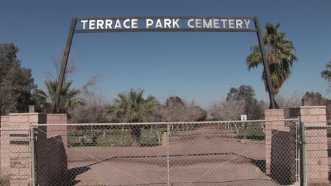 The entrance gates to a cemetery are closed Stock Video Footage