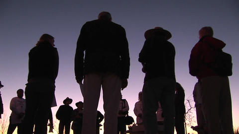 A group of people stand in a circle talking Stock Video Footage