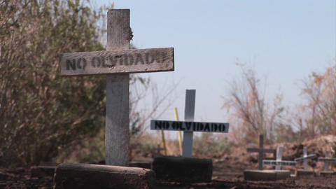 "A pathway is lined with plain wooden crosses marked only with the words, no olvidado"" or not forgott Footage"