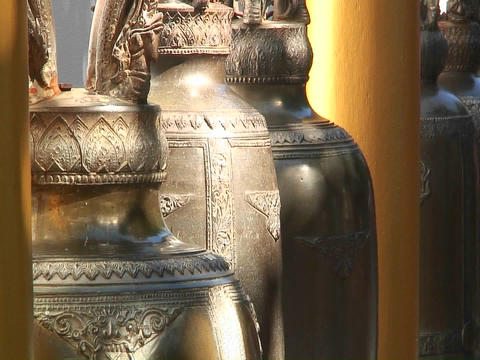 Ornate gold urns hang in a marketplace Footage