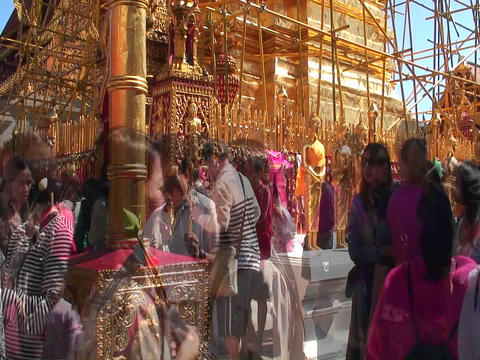 People walk back and forth in front of an ornate gold... Stock Video Footage