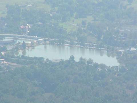 A small town sits around a small body of water in a... Stock Video Footage