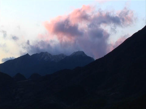 Clouds pass over a mountainous area Stock Video Footage