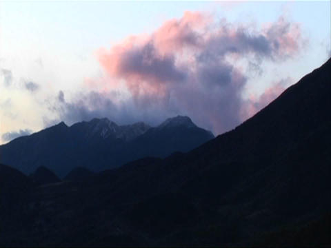 Clouds pass over a mountainous area Footage