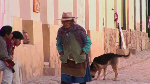 A latin American woman walks down a street in a South... Stock Video Footage