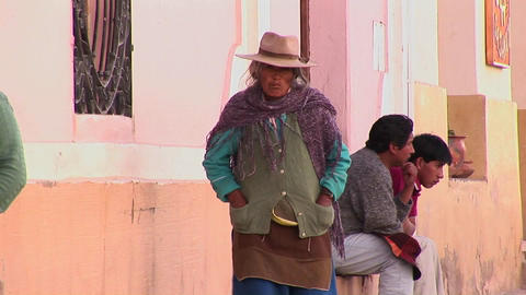 A latin American woman walks down a street in a South American town Footage