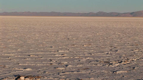 Salt Flat in Alto Plano Argentina with distant mountains Footage
