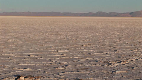 Salt Flat in Alto Plano Argentina with distant mountains Stock Video Footage