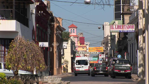 Argentina town with cars and businesses with signs in Spanish Footage