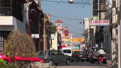 Argentina town with cars and businesses with signs in... Stock Video Footage