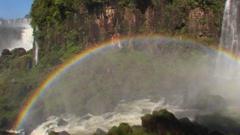 Pan across a rainbow at Iguacu Falls Stock Video Footage