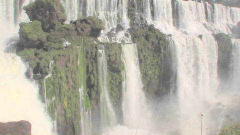 A tilt down of Iguacu Falls flowing at the Brazil Argentina border Footage