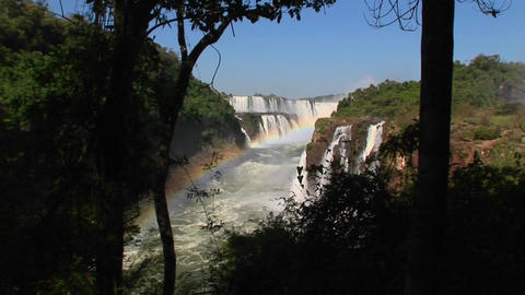 A wide shot of Iguacu Falls with a rainbow in the foreground Footage