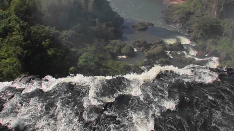 A moving perspective looking over the edge of a waterfall, Iguacu Falls Footage
