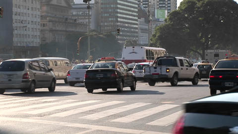 Buenos Aires, Argentina capitol busy street with traffic cu with cars, buses, and bikes Footage