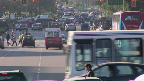 Buenos Aires, Argentina capitol Nuevo de Julio intersection with traffic cu with cars, buses, and Footage