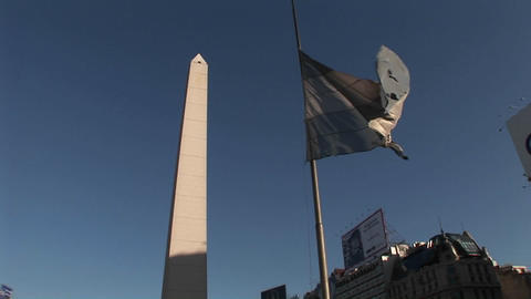 Buenos Aires, Argentina capitol Nuevo de Julio buildings obelisk and Argentine flag Footage