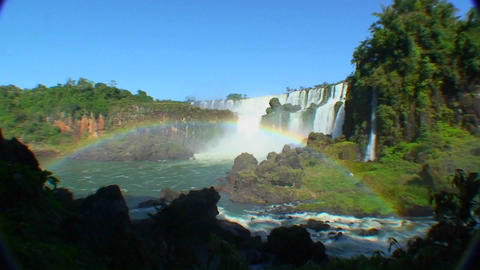 Argentina Iguazu Falls wide angle with rainbow and blue sky Stock Video Footage