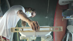 Surfboard making, Shaper measuring blank surfboard with a level ruler Footage