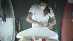 Surfboard making, Shaper using a foam sander to shape the nose of the surfboard Footage